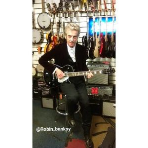 capaldi playing guitar because why the hell not